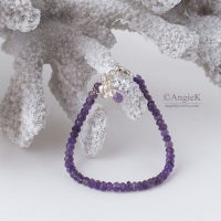 Handmade trendy Amethyst faceted gemstone charm bracetet featuring a Bird Charm and Sterling Silver clasp