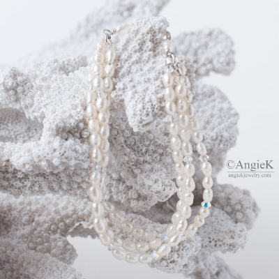 beautiful handmade multi strand Sterling Silver bracelet featuring White Rice Freshwater Pearl Crystal and  Swarovski Elements